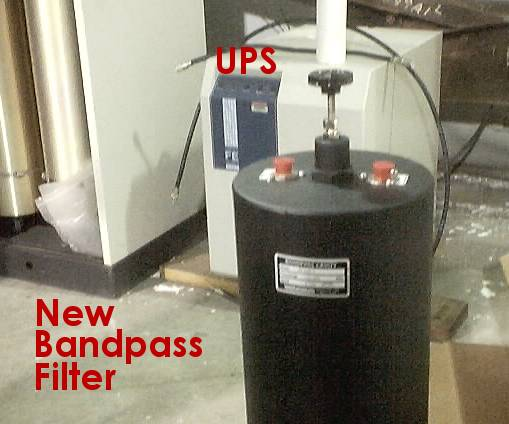 Close-up picture of a recently purchased bandpass filter and of the uninterruptible power supply